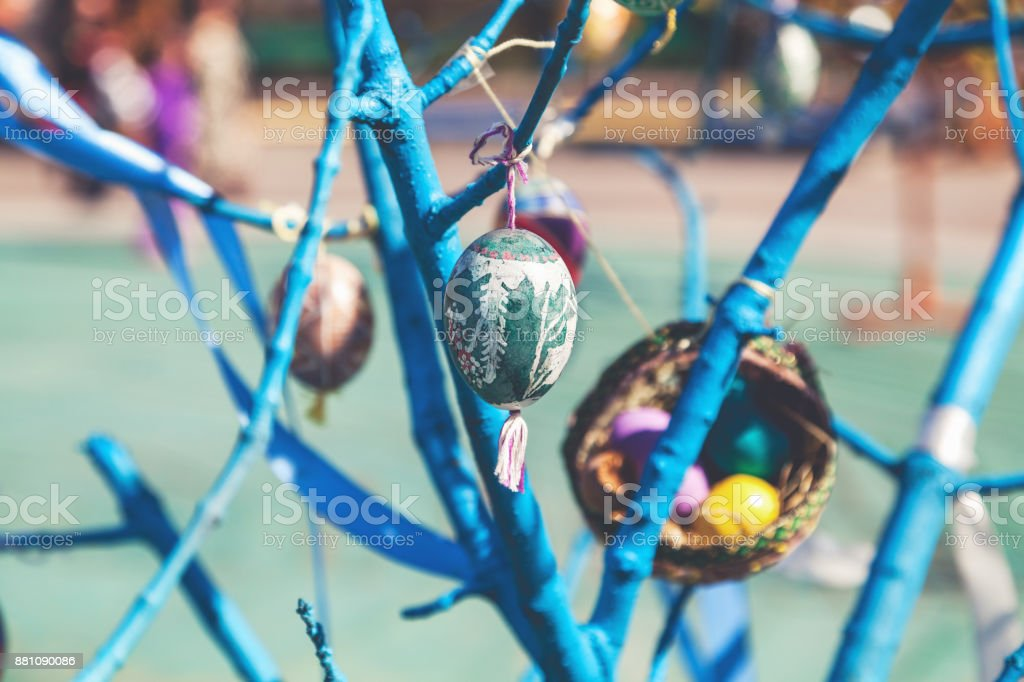 Easter egg hanging on tree branch stock photo