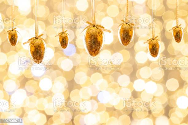 Easter egg hunt easter composition golden shine decorated eggs card picture id1207069746?b=1&k=6&m=1207069746&s=612x612&h=pfy8bte9yrqbbhkt6wy0jdsum8zme4du9dpdwejb8he=