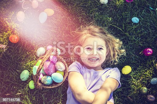 A stock photo of some young girl having fun at an Easter egg hunt