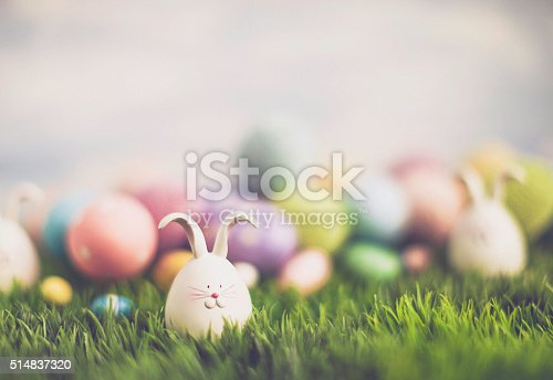 istock Easter egg hunt with bunnies and decorated eggs 514837320