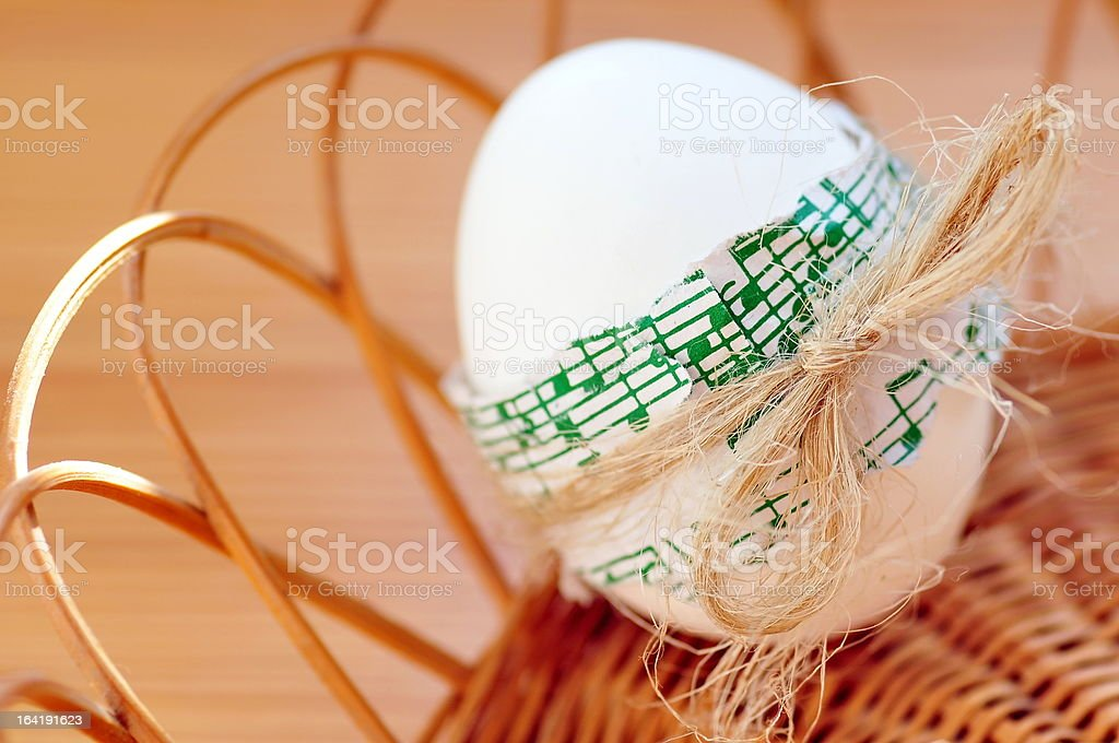 Easter egg in basket royalty-free stock photo