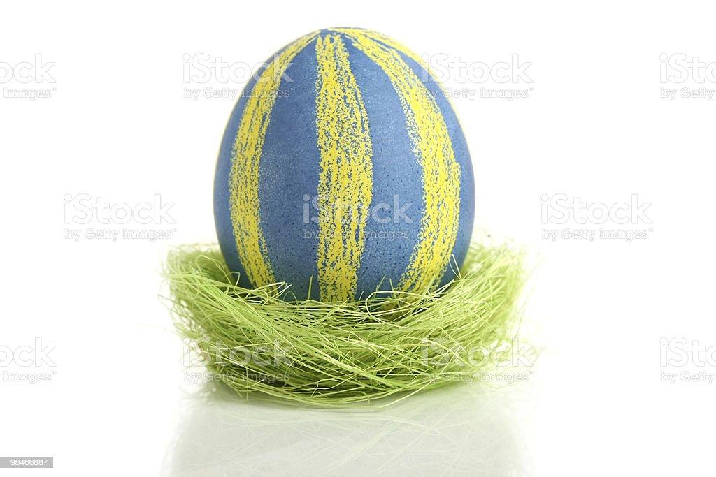 Easter egg in nest royalty-free stock photo