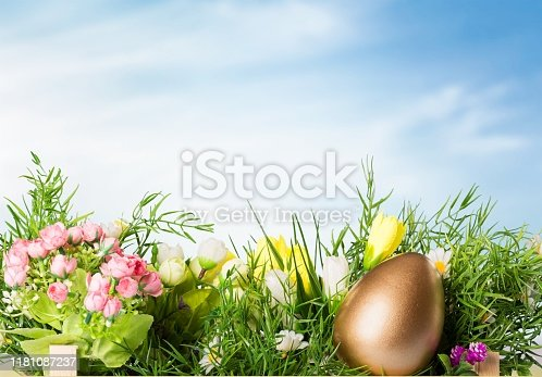 Easter golden egg in flowers