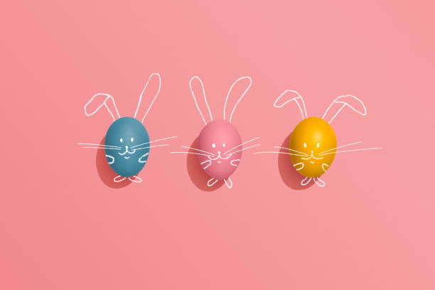 easter egg rabbits on pink background - easter imagens e fotografias de stock