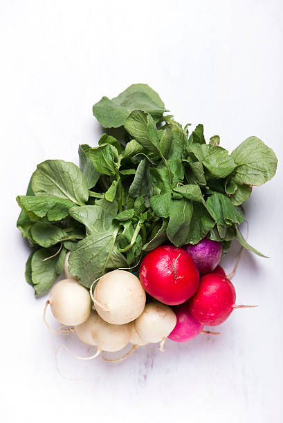 Easter egg radishes on a white board stock photo