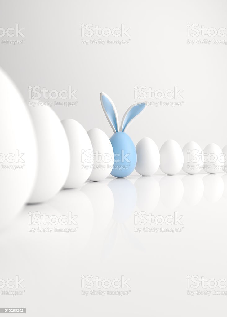 Easter Egg with Blue Bunny Ears Lined Up stock photo