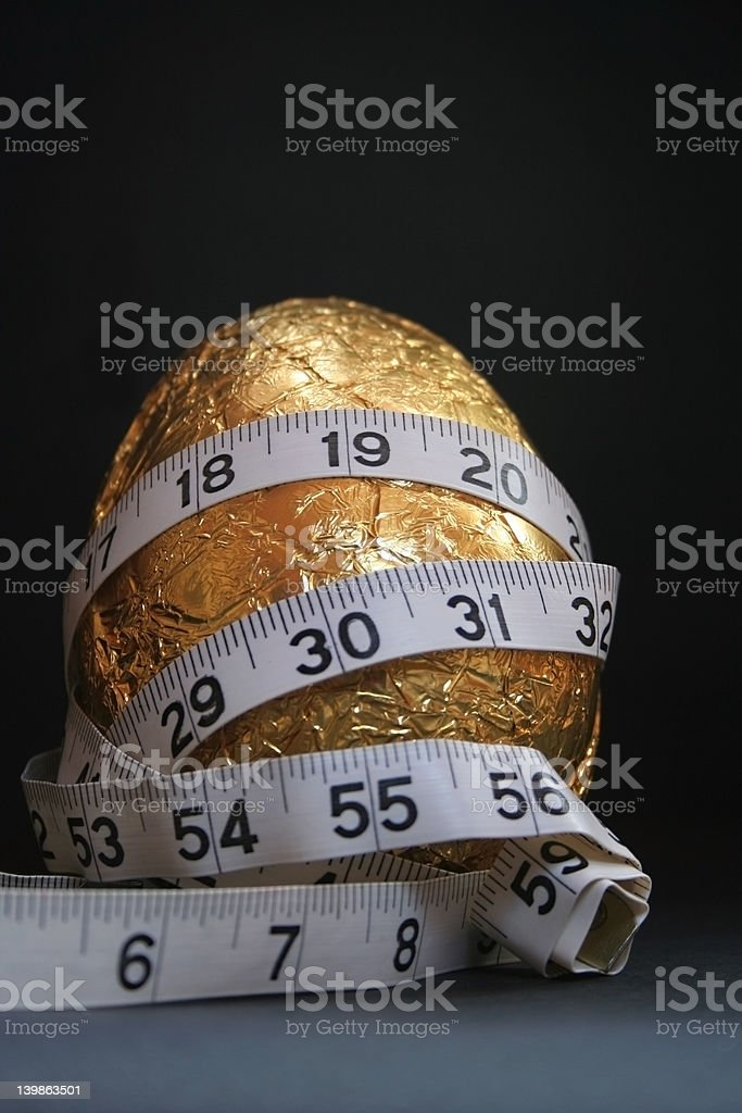 Easter Egg with measuring tape royalty-free stock photo