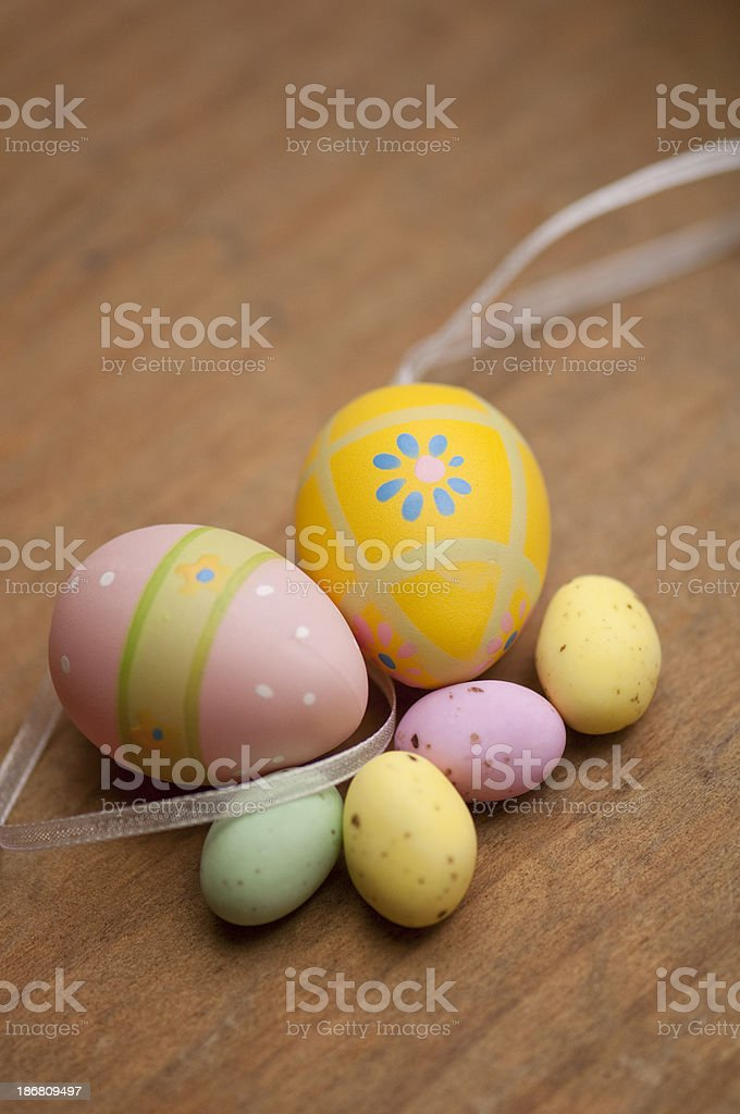 Easter eggs and candy on wood royalty-free stock photo