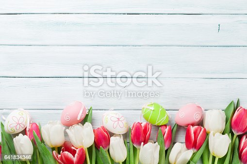 istock Easter eggs and colorful tulips 641834346
