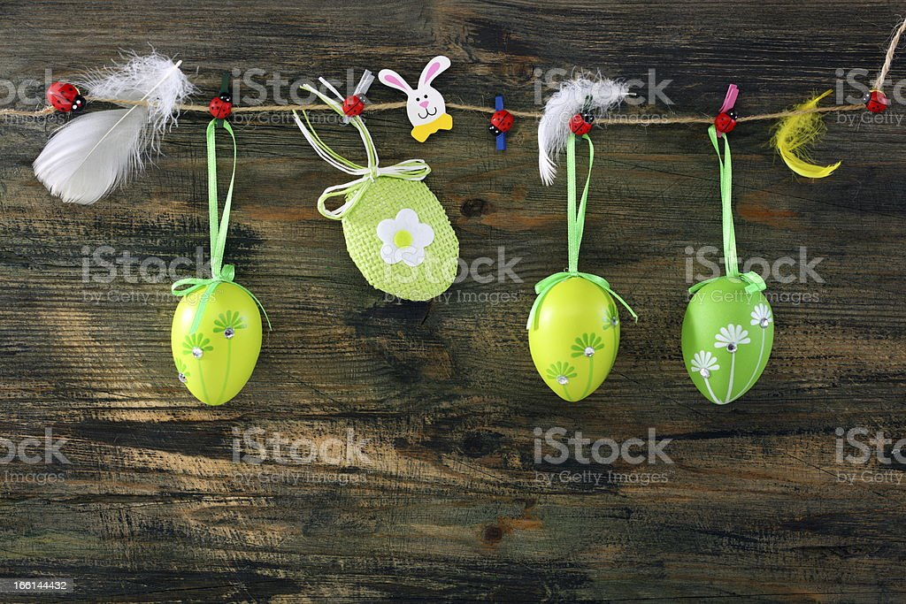 Easter eggs and feathers hanging on a rope. royalty-free stock photo