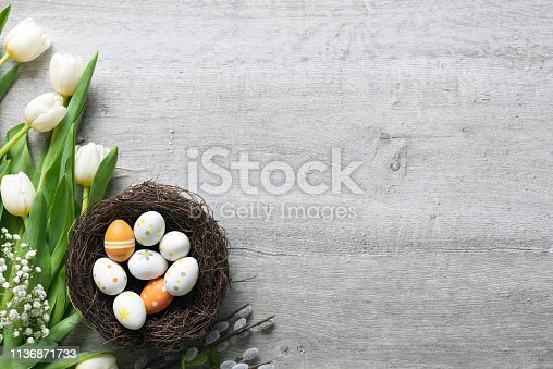 istock Easter eggs and flowers background 1136871733