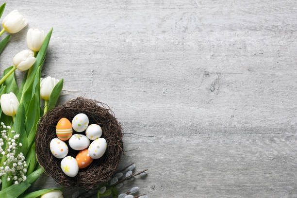 Easter eggs and flowers background Easter eggs and spring flowers background. Top view with copy space. easter stock pictures, royalty-free photos & images