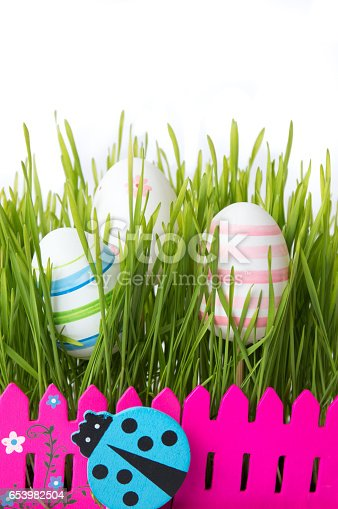 930928526 istock photo Easter eggs and green wheat plant 653982504