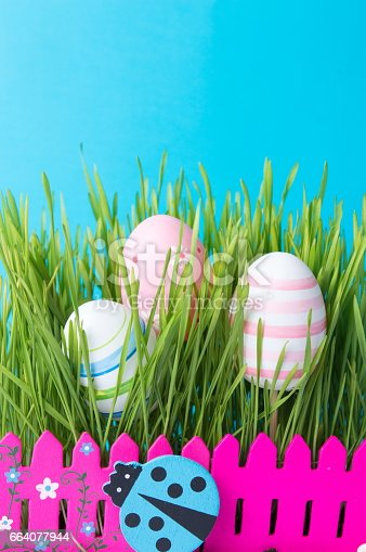 930928526 istock photo Easter eggs and green wheat plant 664077944