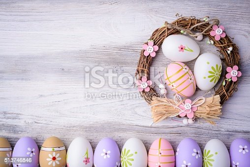 1136239089 istock photo Easter eggs and nest on grey wooden background 513746846