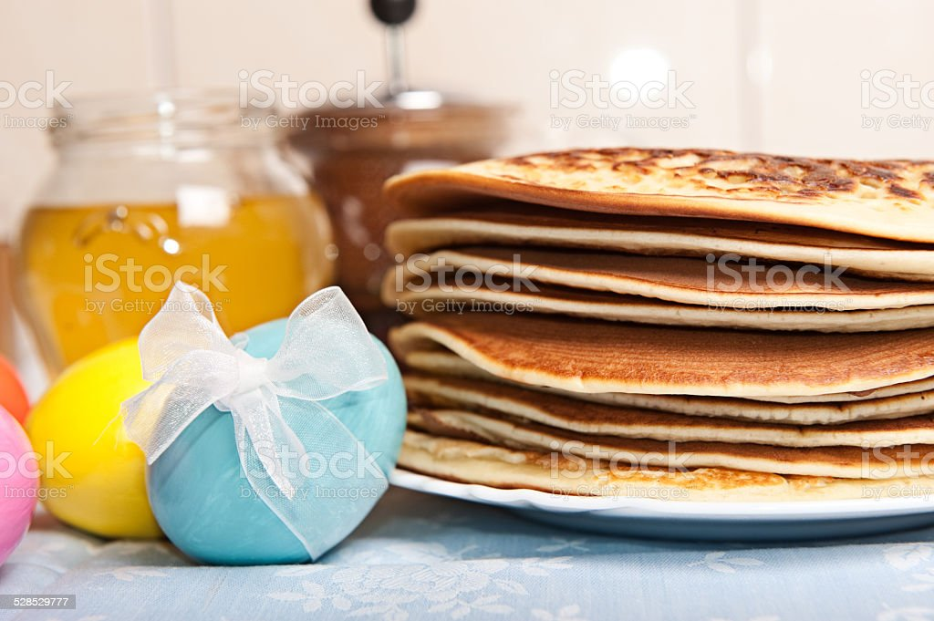 Easter eggs and pancakes stock photo
