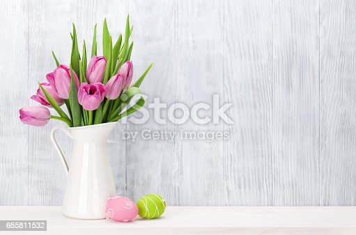 istock Easter eggs and pink tulips bouquet 655811532