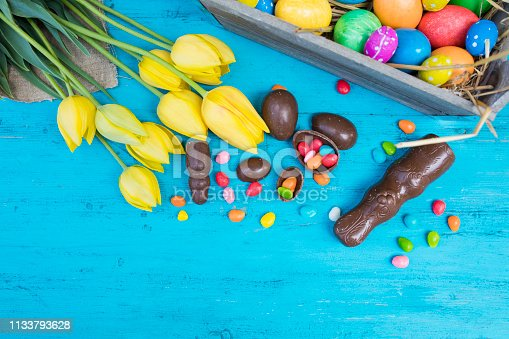 istock Easter eggs and tulips 1133793628