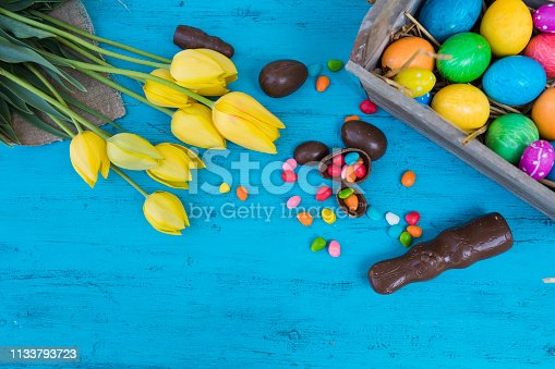 istock Easter eggs and tulips 1133793723