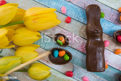 istock Easter eggs and tulips 1133794338