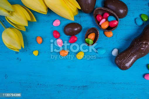 istock Easter eggs and tulips 1133794386