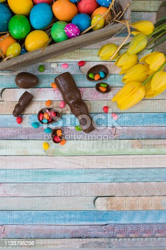 istock Easter eggs and tulips 1133795256