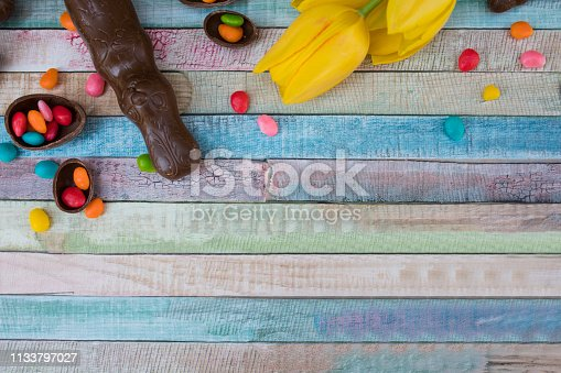 istock Easter eggs and tulips 1133797027