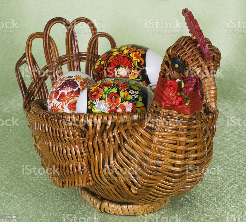 Easter eggs are in a braiding basket royalty-free stock photo