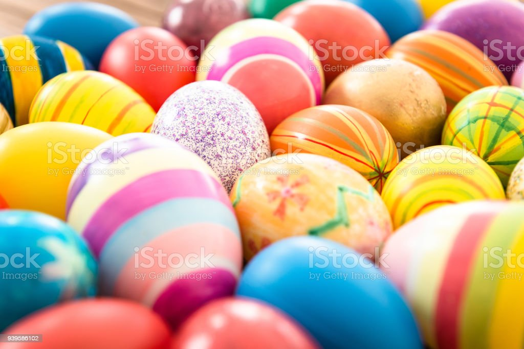 easter eggs background on a plank wood stock photo
