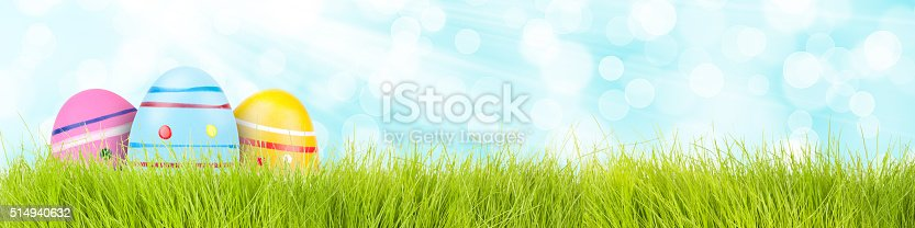 istock easter eggs background with grass 514940632