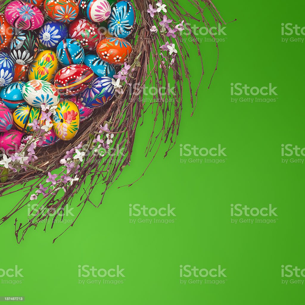 Easter Eggs basket arrangement on green royalty-free stock photo