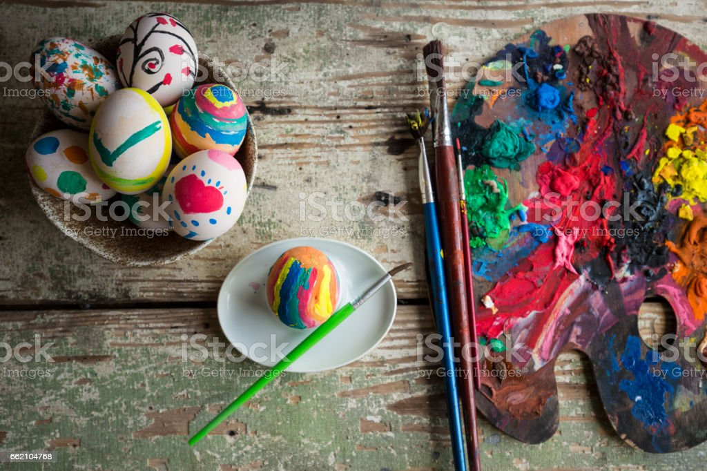 Easter eggs coloring project. Eggs aranged in an old bowl royalty-free stock photo