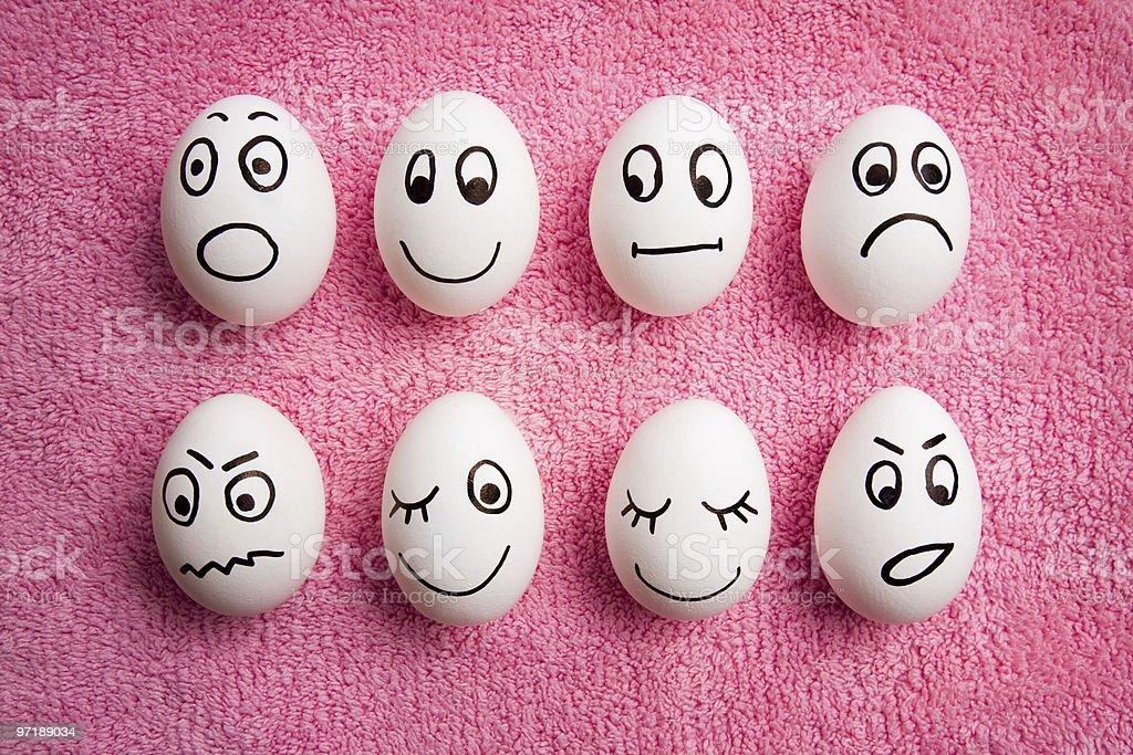 Easter eggs decorated with funny faces stock photo