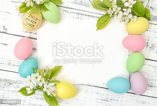 istock Easter eggs decoration Cherry flowers white paper card 923065670
