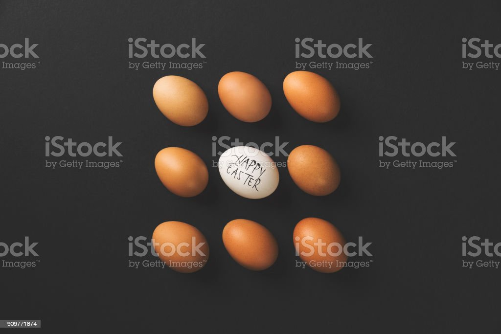 Easter eggs flat lay on black background stock photo