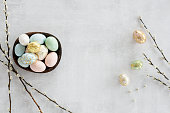 Flat lay of easter eggs on concrete textured background