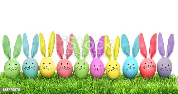 istock Easter eggs funny bunny green grass 666779876