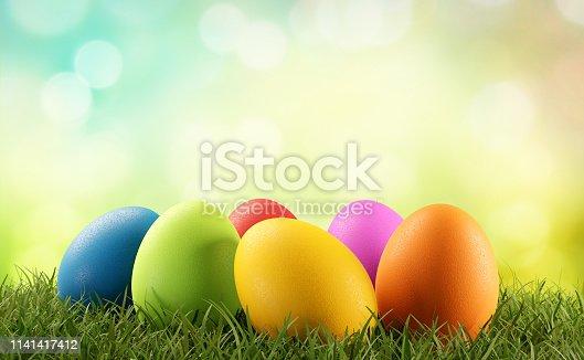 istock Easter eggs green grass 3d-illustration 1141417412