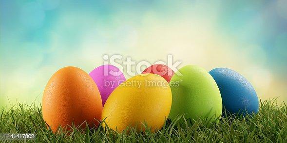 istock Easter eggs green grass 3d-illustration 1141417802