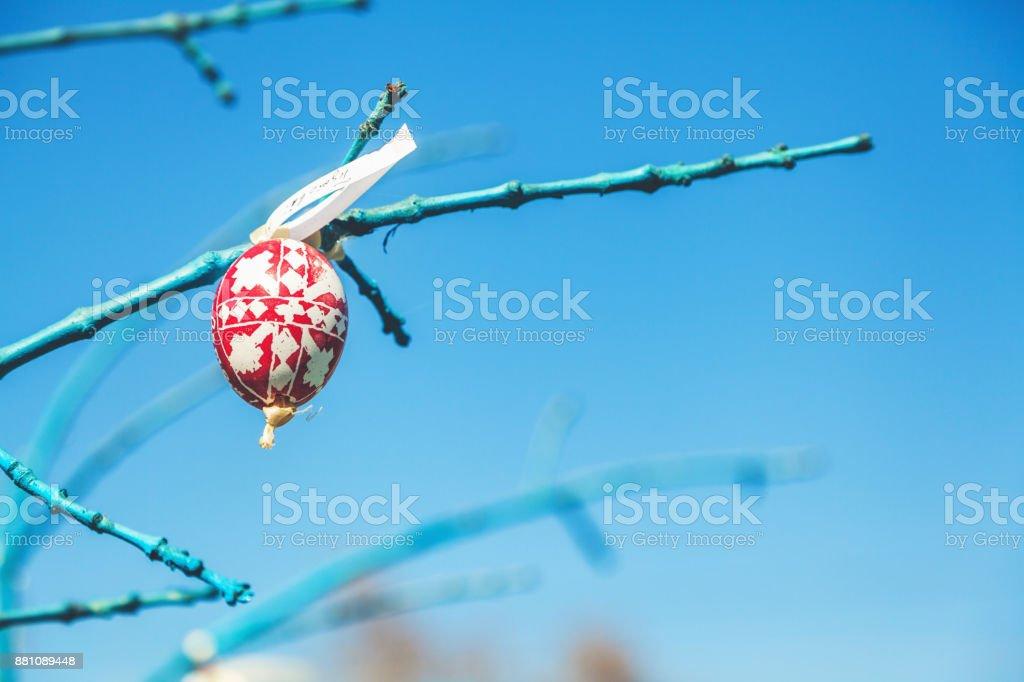 easter eggs handmade hanging on tree branch stock photo