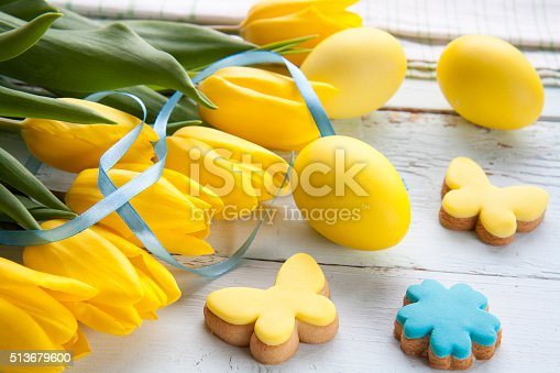 Easter Eggs Homemade Cookies And Yellow Tulips Stock Photo & More Pictures of April