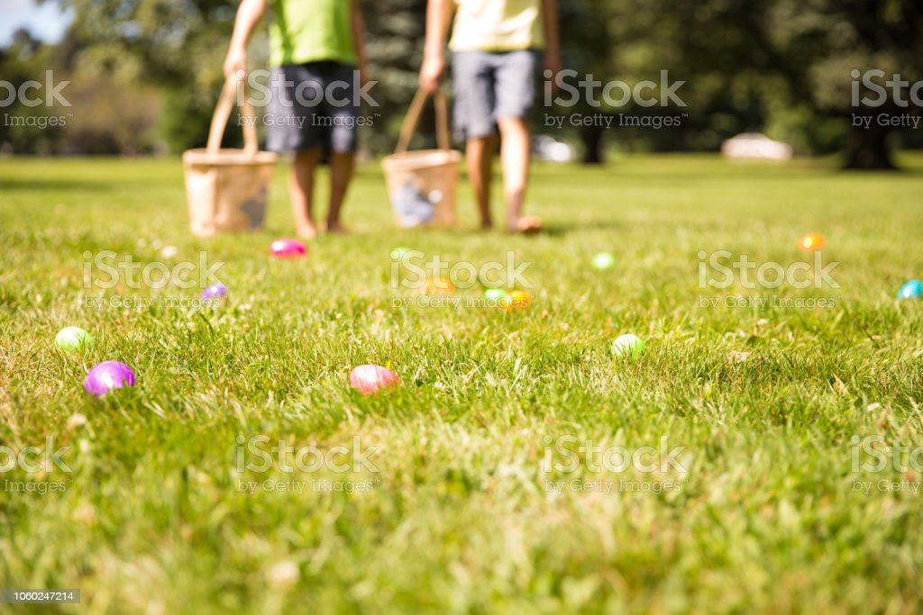 easter eggs hunt. Blurred silhouettes of children with baskets in hands. stock photo