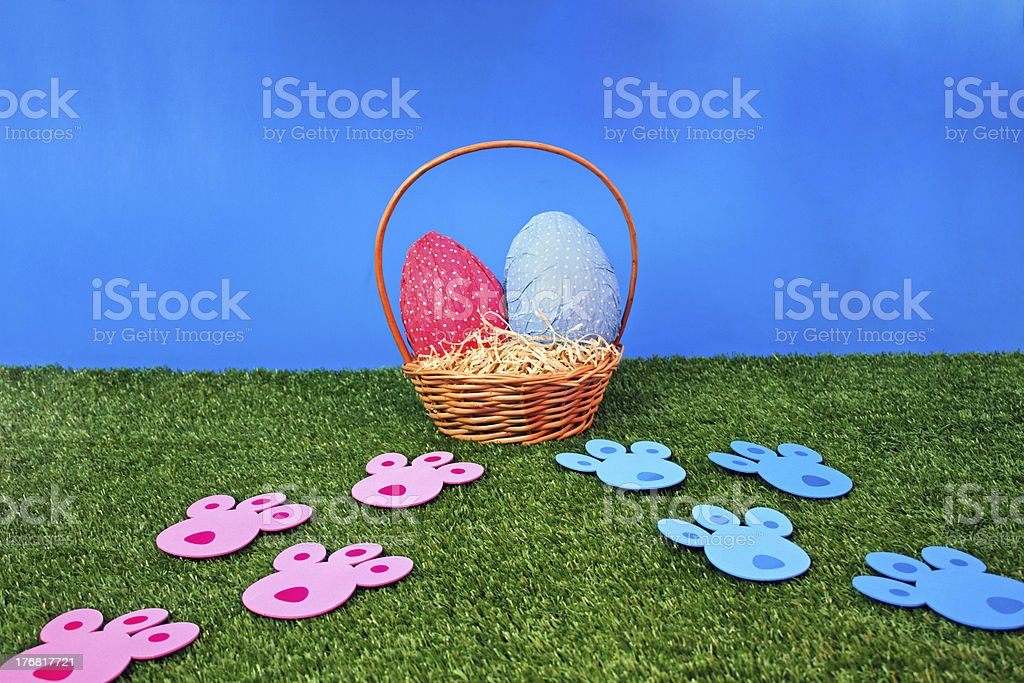 Easter eggs hunt with bunny tracks royalty-free stock photo