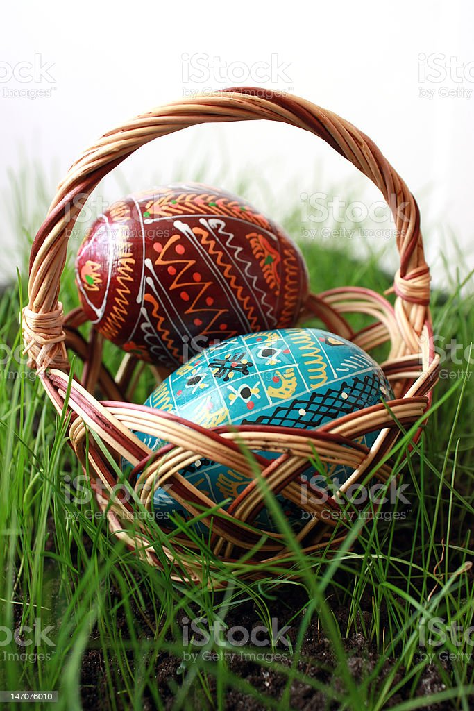 Easter eggs in a basket on grass. royalty-free stock photo