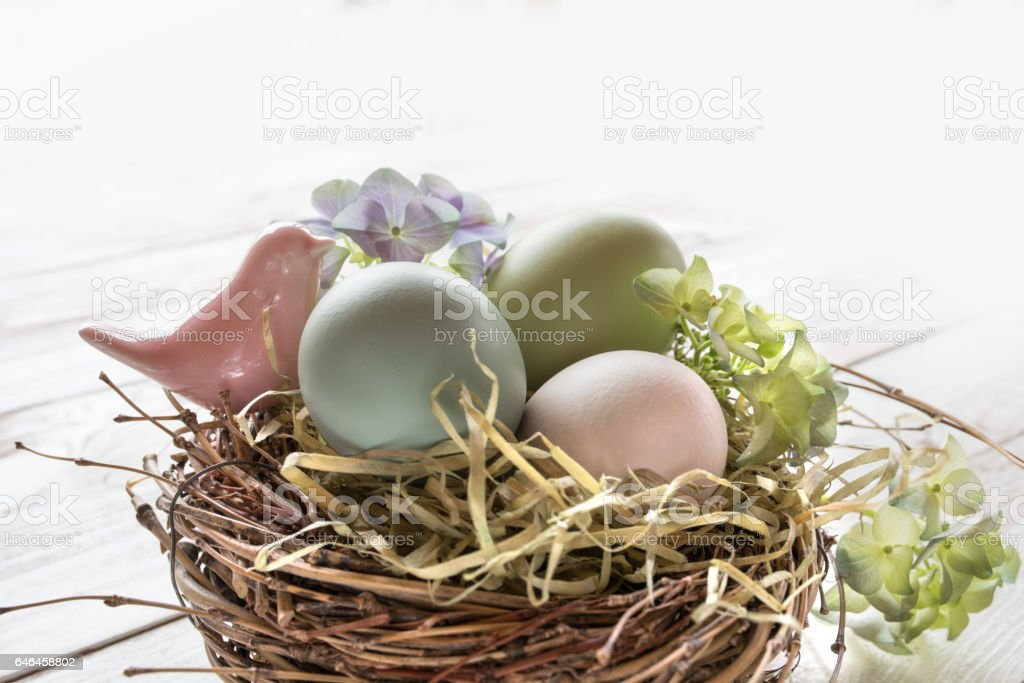 Easter eggs in a nest of straw stock photo