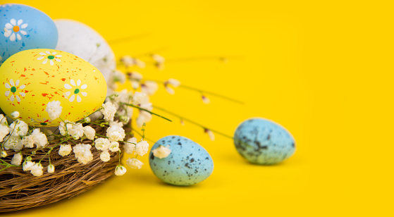 Easter Eggs on Yellow Background with Copy Space