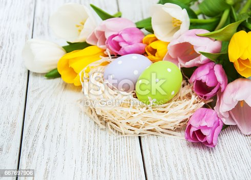 istock Easter eggs in a nest 667697906
