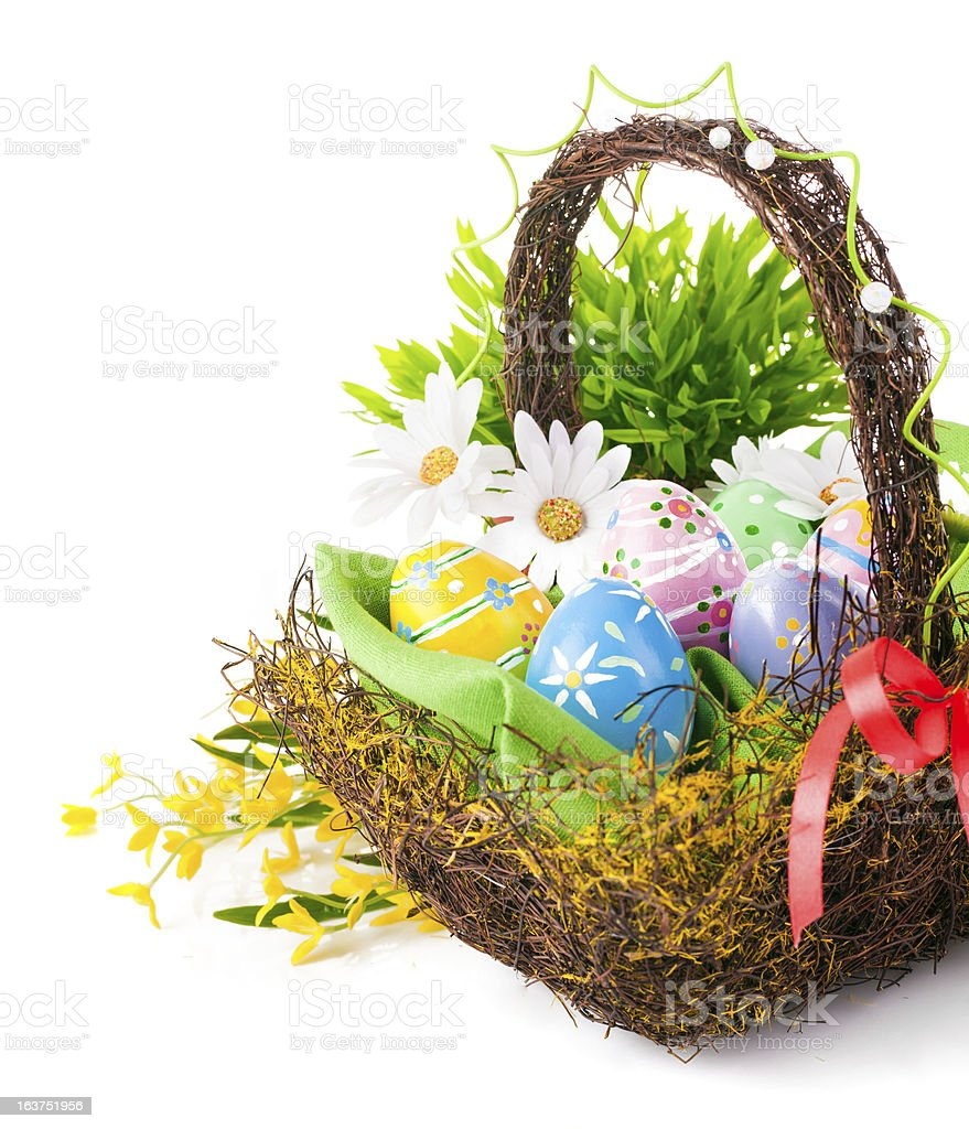 easter eggs in basket with spring flowers royalty-free stock photo