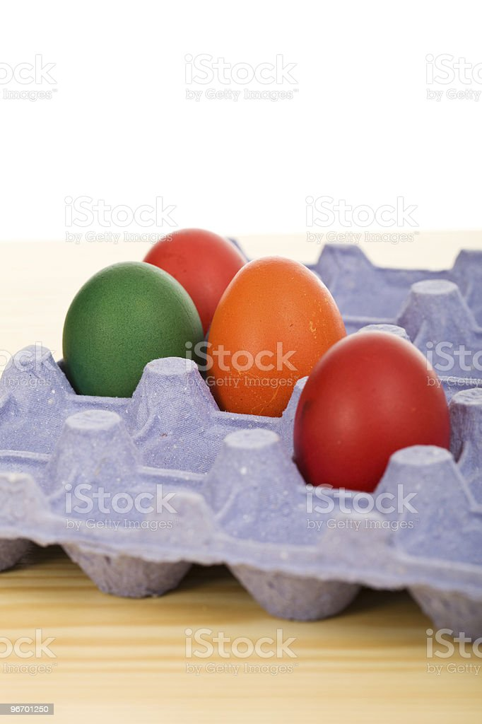 Easter eggs in blue carton royalty-free stock photo