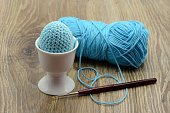 Easter eggs in cup crochet in blue. wool ball in background